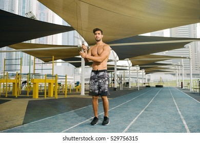 young man exercising with jumprope outdoors