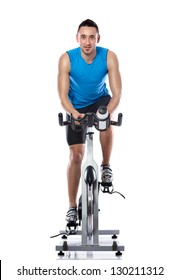 Young man exercising on a bike,  spinning exercise class