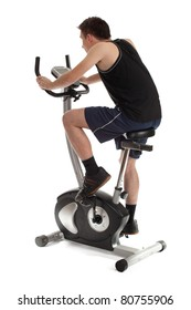 young man exercising on stationary training bicycle