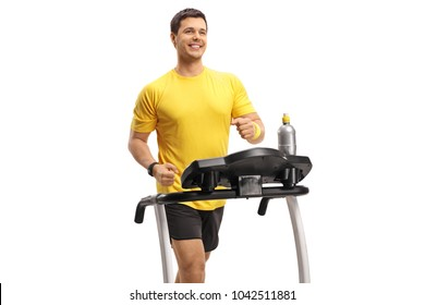 Young man exercising on a treadmill isolated on white background