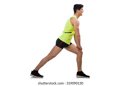 Young man exercising on white