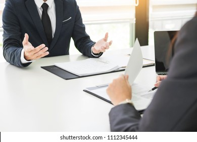 young man explaining about his profile to business managers sitting in job Interview.