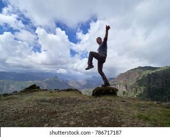 young man exploring mountains, beautiful panoramic view