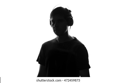 young man face listening to music using headset equipment, black and white guy on white isolated background