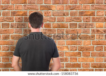 Young Man Facing Bricks Wall Stock Photo Edit Now 158083736
