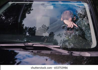 Young man fall asleep in a car