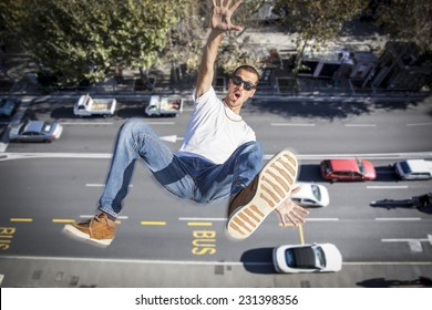 young man falling down of a building