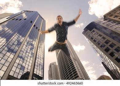 Young man falling down of a building in city center