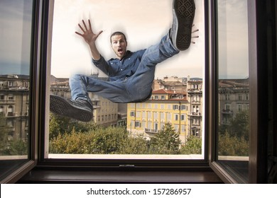 young man falling down a window