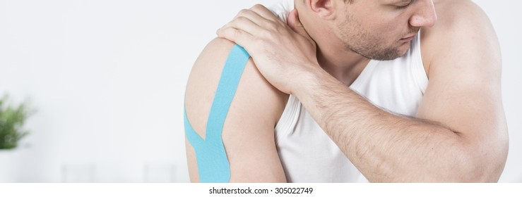 Young man is feeling pain in his arm