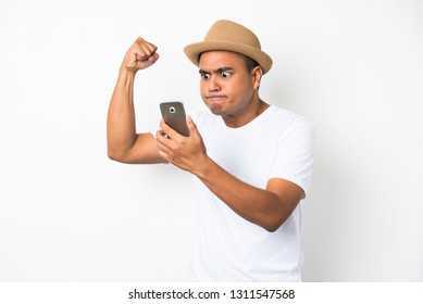 Young man feels angry looking at smartphone.