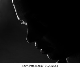 young man fine-art high-contrast portrait in backlight