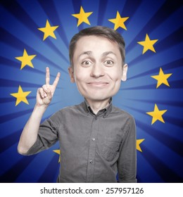 "Young man with the fingers in a ""victory"" sign  on background of the flag of Europe"