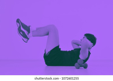 young man in fintess sport club exercise withweights and relaxing duo tone