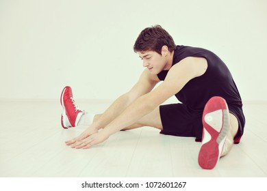 young man in fintess sport club exercise withweights and relaxing