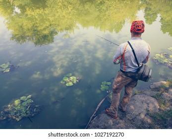 Young man fishing. bokeh , blurred background
