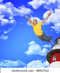 young man fly away in blue cloudy sky