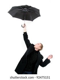 young man flying away with umbrella over white
