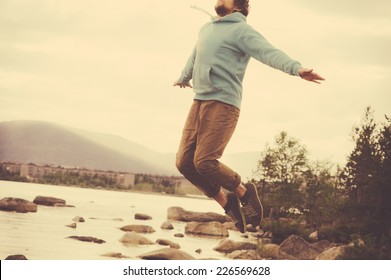 Young Man Flying levitation jumping outdoor relax Lifestyle Travel happiness spiritual concept retro film colors