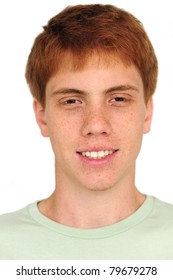 young man with freckles on white background