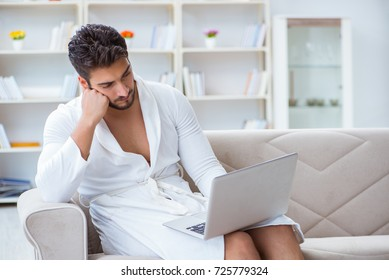 Young man freelancer working from home on a laptop