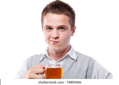 Young man with fresh cup of black tea