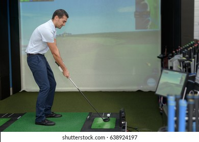 young man gaming golf in vr headset