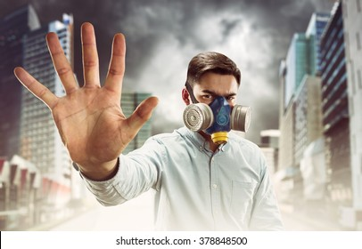 Young man in gas-mask