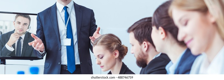 Young man gesturing during business video conference