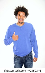 Young man gesturing thumb up on white background