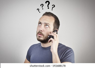 young man gesturing while answering smart phone not understood