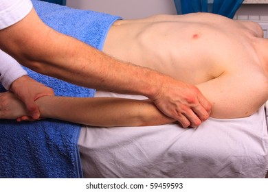 Young man gets arm massage
