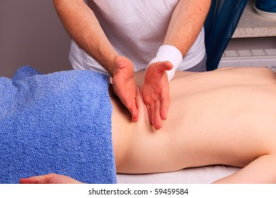 Young man gets back massage
