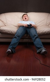 young man gets tired while playing video games on gray background
