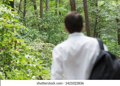 Young man is getting away from urban area to go hicking in the forest