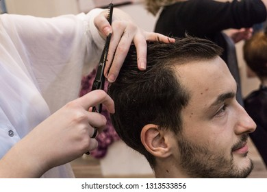 Young man getting his hair cut