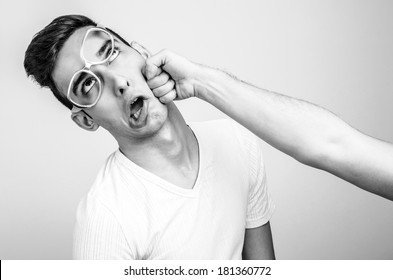 Young man getting punched in the jaw. Hand of a man hitting in the face other man. Violence and bulling.