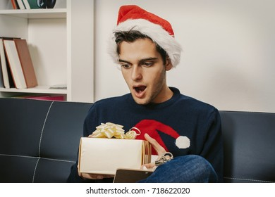 Young man with gift box, holiday and christmas