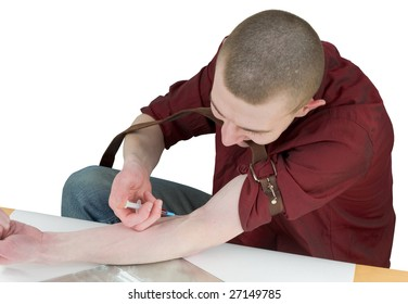 Young man to give an injection himself on white