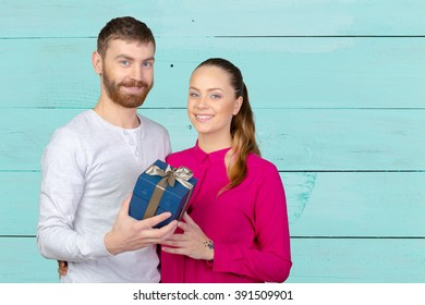 Young man gives woman a gift
