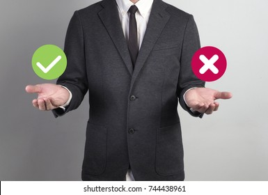 Young man giving empty hand on white background.Hands open businessman. some object are here.right or wrong option for select
