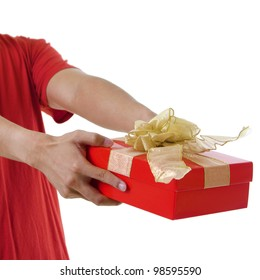 Young man giving a gift box on white background