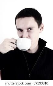 Young man giving us asian natural tea ceramic cup