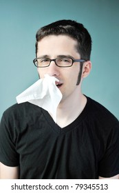 A young man with glasses and a nose bleed.