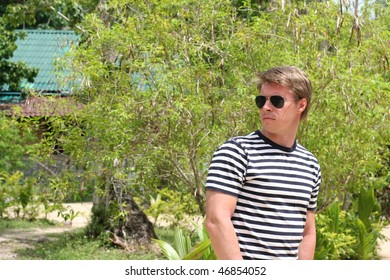 young man with glasses on vacation