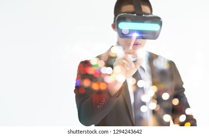 Young man with glasses of virtual reality. Future technology concept.Smartphone using with VR goggles headset. Horizontal,flares effect, blurred background.