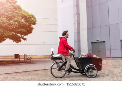 Young man going back from shopping with a cargo bike