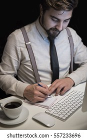 Young man in gray suit working with laptop, man's hands on computer, business person at workplace