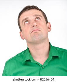 Young man in green shirt with facial emotion