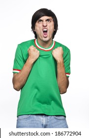 Young Man with green shirt or jersey  Shouting and feasting I fill of happiness and emotion on white background